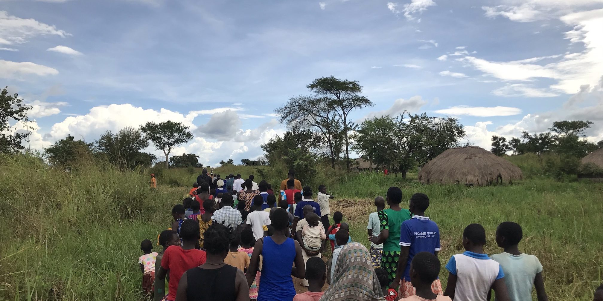 The people of the villages gather to walk to the new clean water well.